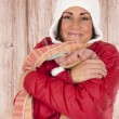 Smiling female model in winter outfit hugging herself — Stock Photo #40385749