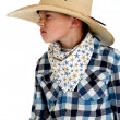 Young cowboy with sneering expression wearing huge cowboy ha — Stock Photo #40922499
