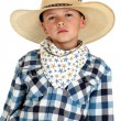 Young cowboy with a serious look wearing a large hat — Stock Photo