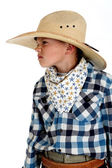 Young cowboy with a sneering expression wearing a huge cowboy ha — Stock Photo