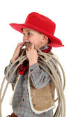 Young cowboy playing with a rope wearing a red hat — Stock Photo