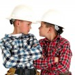 Two young  brothers sneering at each other wearing construction  — Stock Photo #41656493
