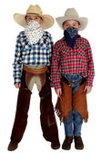 Two young cowboys with bandannas covering their faces — Stock Photo