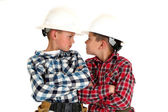 Two young  brothers sneering at each other wearing construction  — Stock Photo