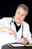 Handsome blue eyed mature medical doctor consulting  patient  — Photo