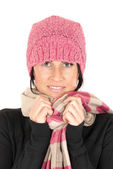 Pretty brunette wearing a pink hat and scarf looking at camera — Stock Photo