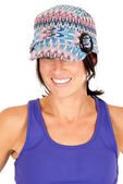Pretty brunette wearing knit hat and purple tank top — Stock Photo
