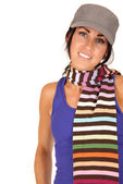 Pretty female wearing hat and multi-colored striped scarf — Stock Photo