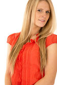 Attractive blond female model wearing a red blouse — Stock Photo