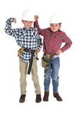 Two tough boys wearing construction hats and belts — Stock Photo