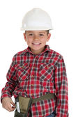Young boy in a construction hardhat smiling — Stock Photo