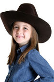 Cute young cowgirl missing her front teeth smiling — Stock Photo