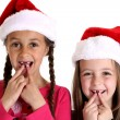 Girls wearing santa hats missing their two front teeth — Stock Photo #45118205