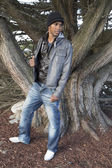 African American male model casual dress standing by a tree — Stock Photo