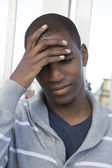 African American male model hand on head thinking or pondering — Stock Photo