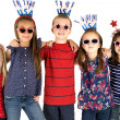 Five patriotic children standing arm in arm smiling — Stock Photo #48395967