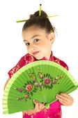 Adorable girl in Asian dress showing a coy expression — Stock Photo