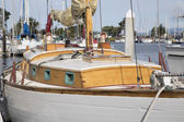 White wood  sailboat in harbor marina  — Stockfoto