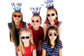 Beautiful children wearing patriotic headbands and dark glasses — Stock Photo