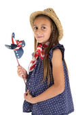 Beautiful young girl holding a patriotic windmill — Stock Photo