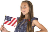 Cute brunette girl holding an American flag smiling — Stock Photo