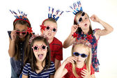 Five cousins dressed patriotic being silly with funny expression — Stock Photo