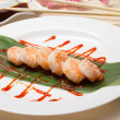 Fried shrimp wirh soy sauce on dish decorated with sakura — Stock Photo