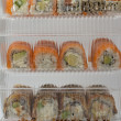 Sushi rolls in plastic boxes — Stock Photo