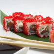 Stock Photo: Sushi roll in red tobiko