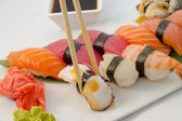 Sushi nigiri salmon tuna eel and shrimp — Stock Photo