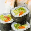 Постер, плакат: Sushi vegetarian roll and roll with shrimp