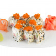 Isolated sushi roll with salmon roe sesame wasabi and ginger — Stock Photo #33399913