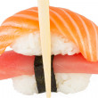 Isolated salmon and tuna nigiri in chopsticks and white background — Stock Photo