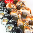 Постер, плакат: Sushi roll with red black tobiko and canada roll
