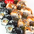 ������, ������: Sushi roll with red black tobiko and canada roll