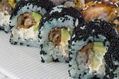 Sushi roll with black tobiko and canada roll — Stockfoto