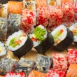 Vegetarian sushi roll with made dish sushi rolls on background — Stock Photo #33947703