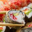 Takusen warm or hot sushi roll with tempura red tobiko and avocado — Stock Photo