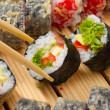 Vegetarian sushi roll with made dish sushi rolls on background — Стоковая фотография