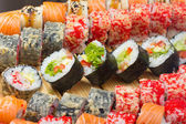 Vegetarian sushi roll with made dish sushi rolls on background — Stock Photo