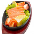 Fresh raw salmon fish pieces on plate isolated — 图库照片