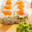 Sushi roll with sesame and caviar — Stock Photo