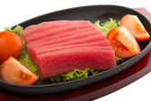 Fresh raw tuna fish pieces on plate isolated — Стоковое фото
