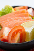 Fresh raw salmon fish pieces on plate isolated — Stock Photo