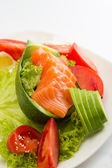 Raw salmon fillet on sticks with vegetables — Stock Photo