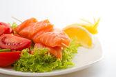 Raw salmon fillet on sticks with vegetables — Zdjęcie stockowe