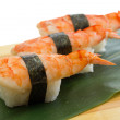 Stock Photo: Shrimp sushi nigiri on wooden plate