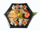Sushi roll on a plate isolated on white background — Stock Photo
