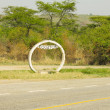 Sign of the equator on the road in Uganda. — Stock Photo