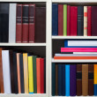 Books on a white shelf — Stock Photo